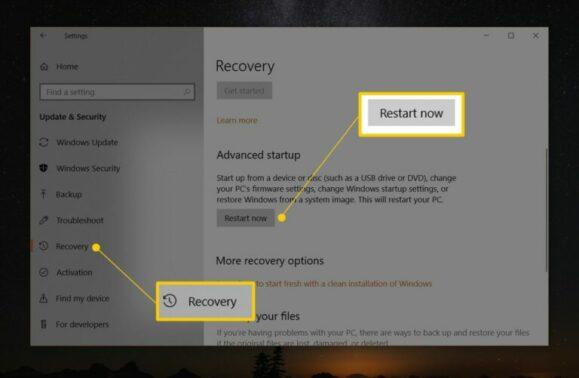 Selanjutnya akses tab Recovery dan klik tombol Restart Now di submenu Advanced startup